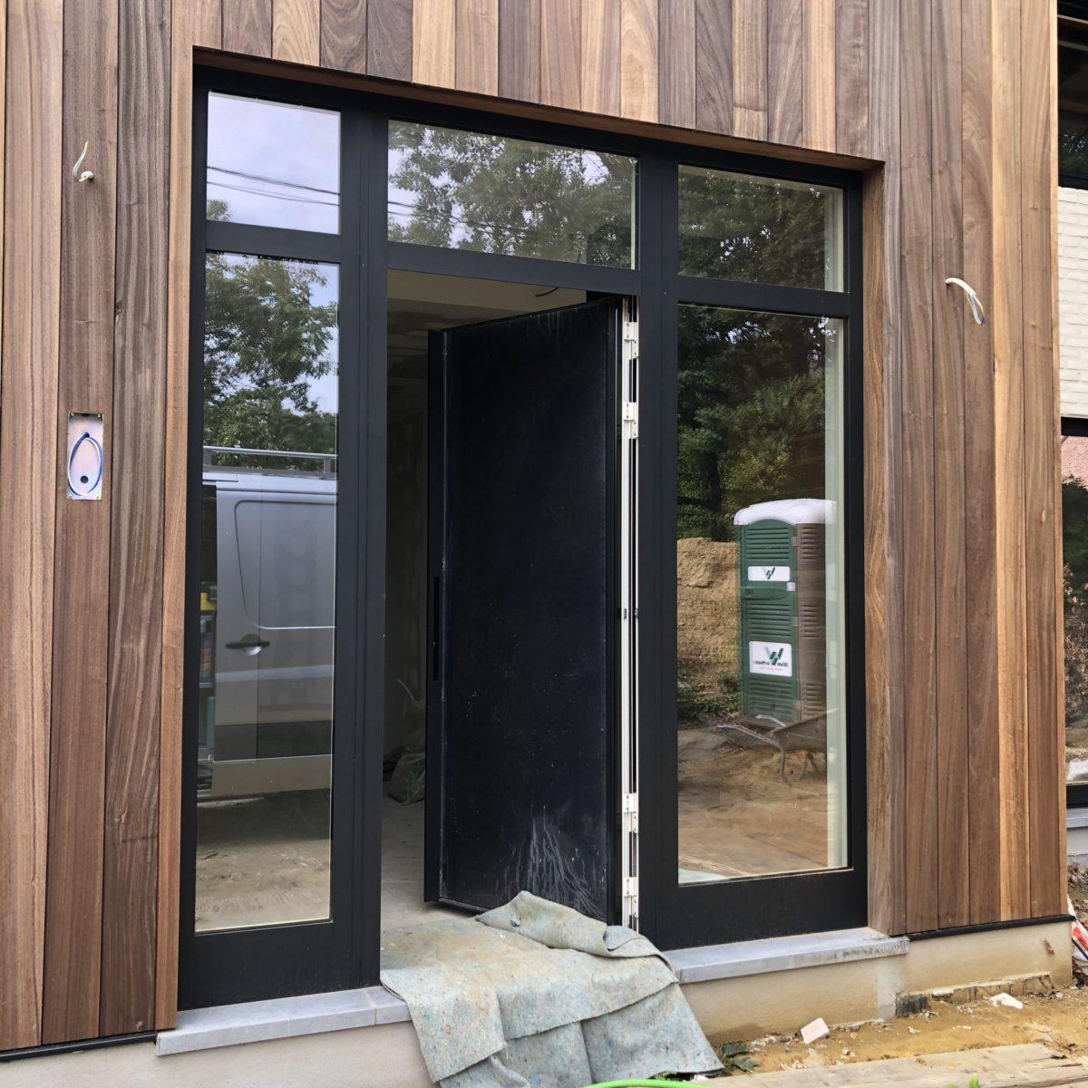 uitbreiding bestaande massieve houtbouw woning te Tremelo